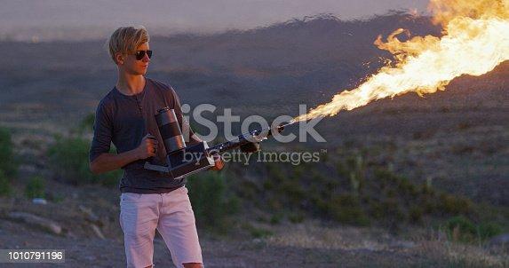 Teenager Shoots a Flamethrower in a Desert