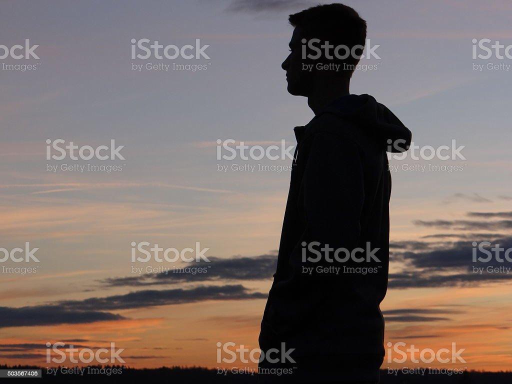 Teenager silhouette stock photo