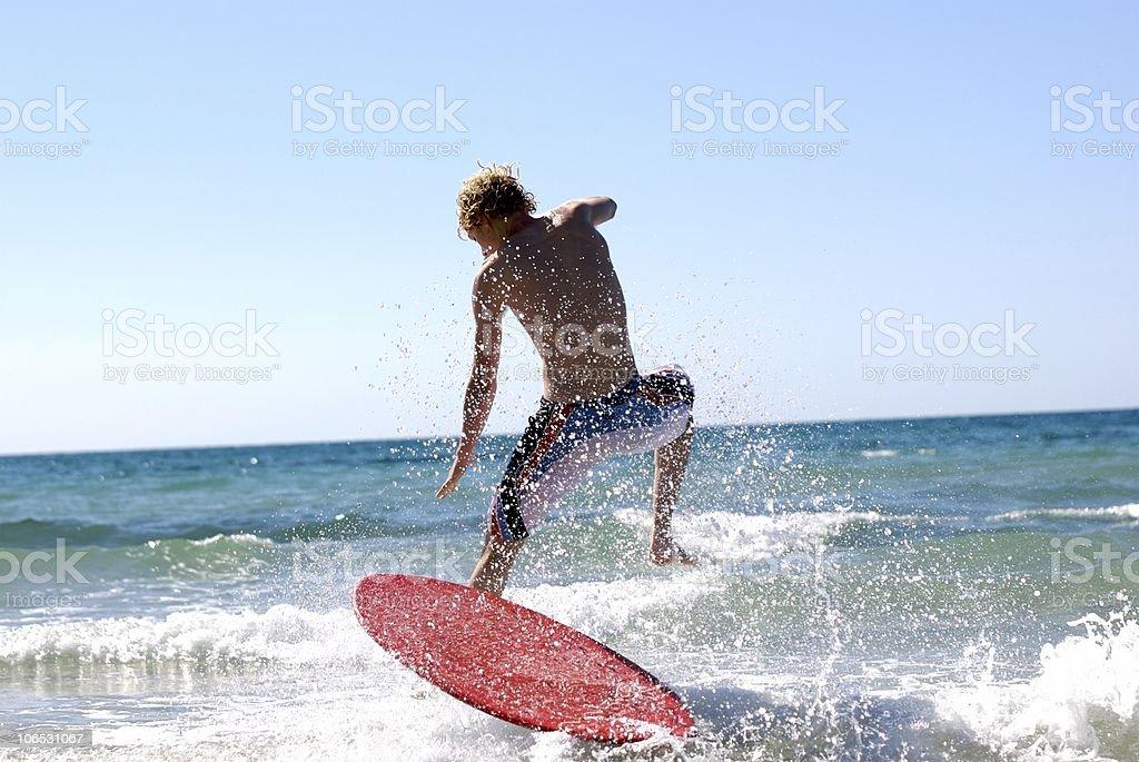 Teenager Skimboarding. stock photo