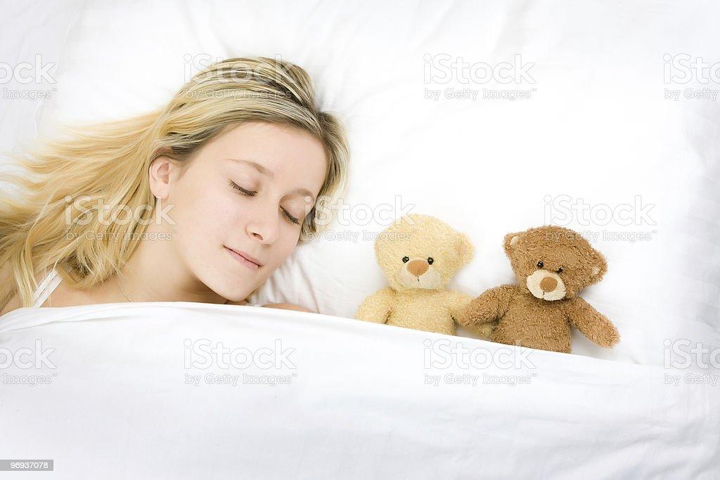 Teenager sleeping with teddies royalty-free stock photo