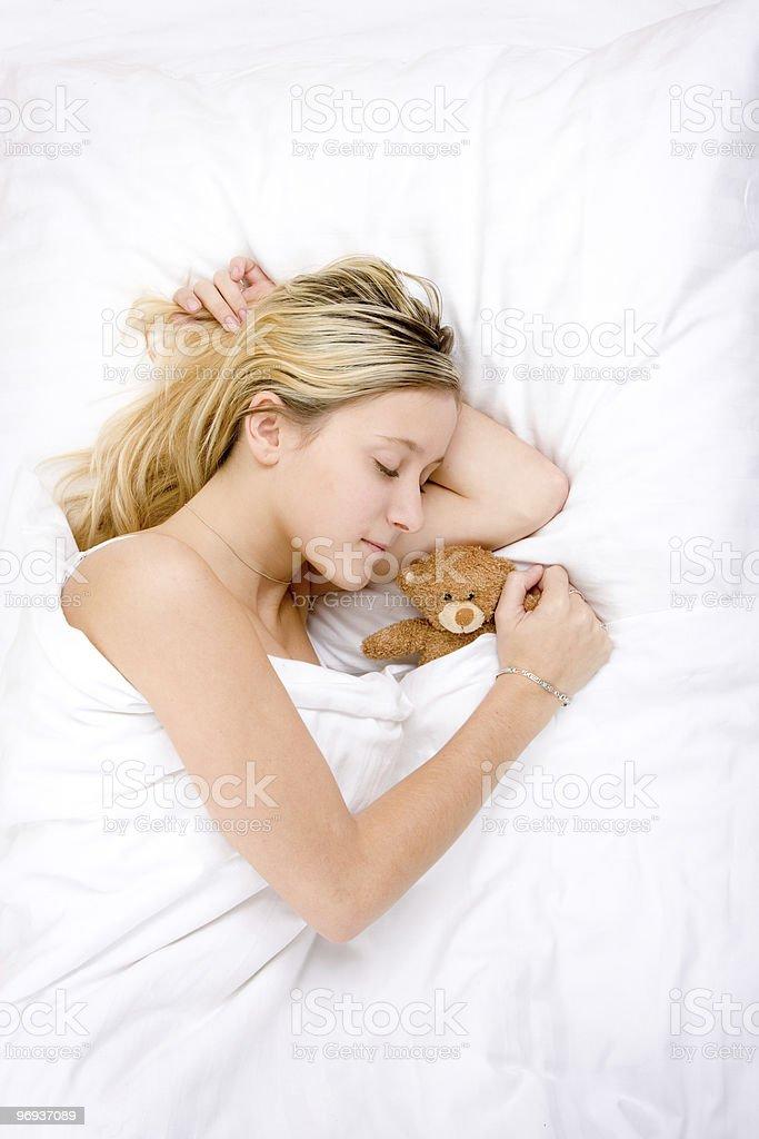 Teenager sleeping with teddy royalty-free stock photo