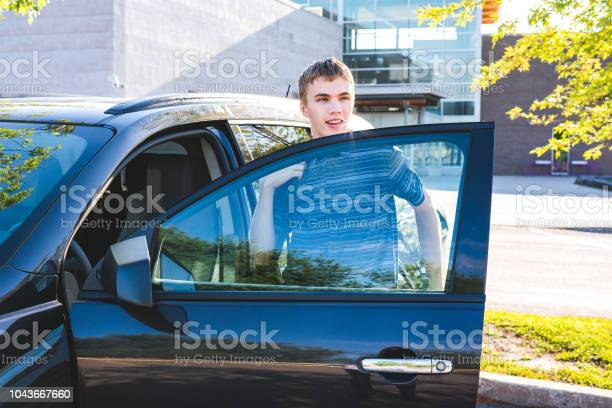 Teenager stepping out of his car on the first day of school picture id1043667660?b=1&k=6&m=1043667660&s=612x612&h=juj9zb9a2jhv9wlrtnse2bypk9afvk4mfiqvxniku6u=