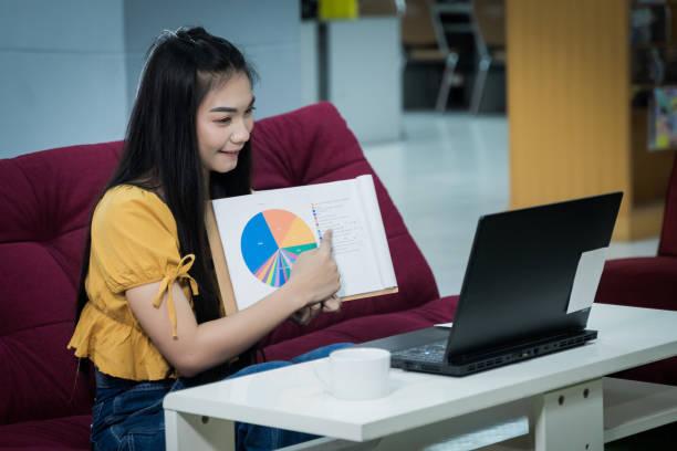 Teenager student presents her work online stock photo