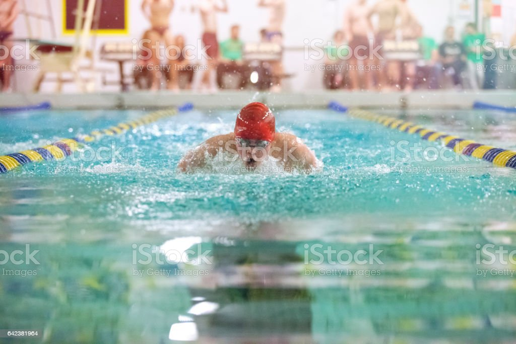 Teenager swimming butterfly stock photo