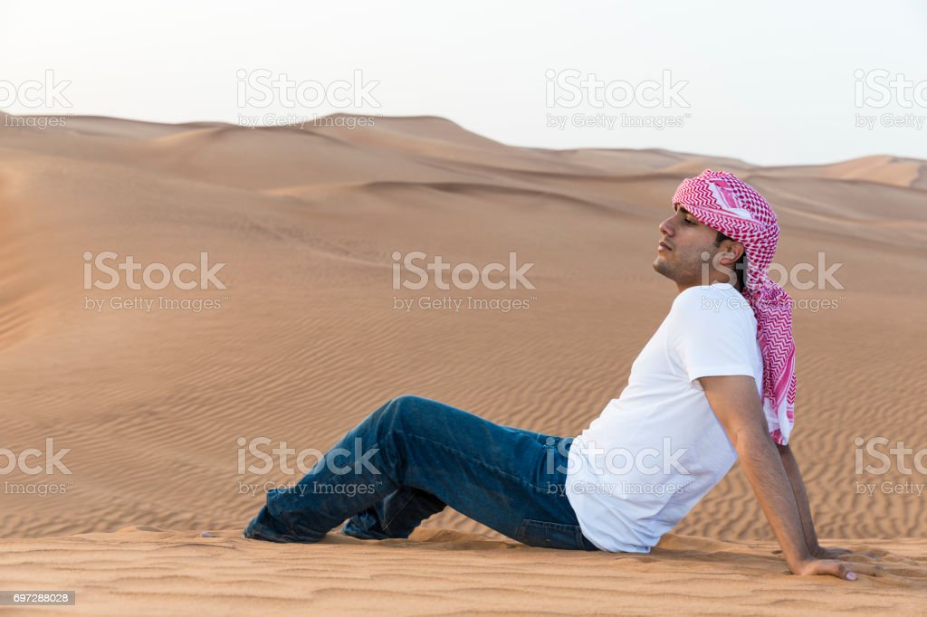 Teenage tourist in the Arabian desert.