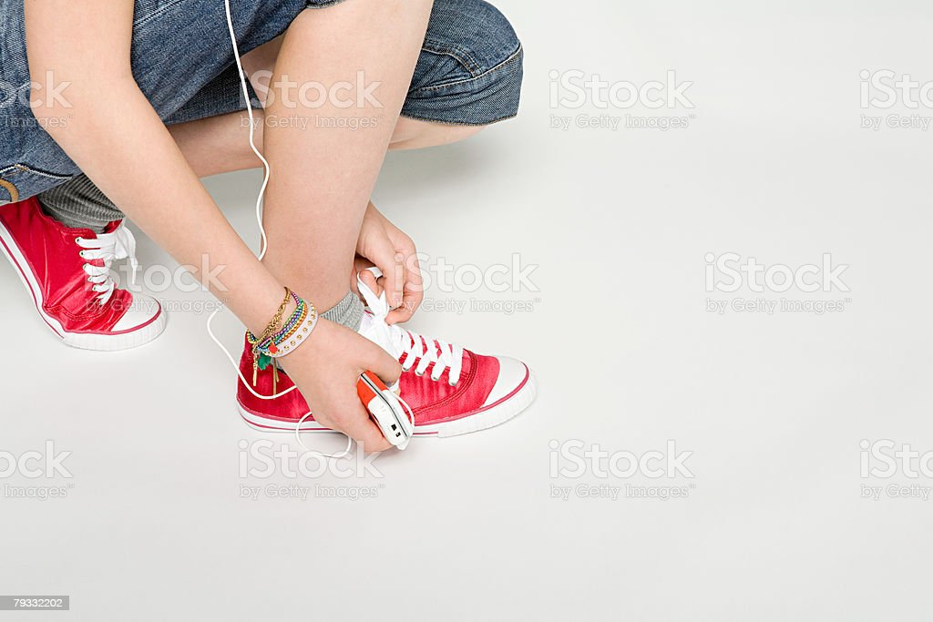 A teenager tying shoelace royalty-free stock photo