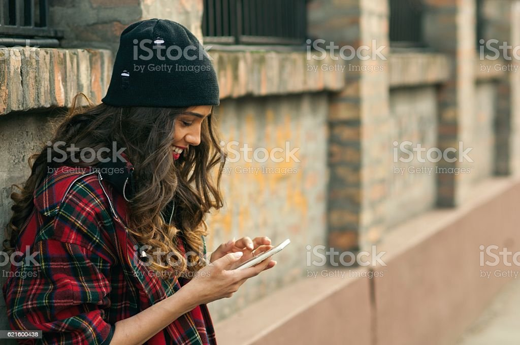 Teenager using mobile phone. stock photo