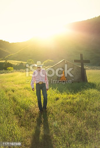 Teenager walking by a small tent church in a ranch