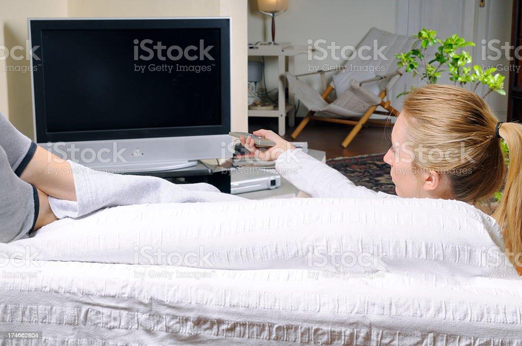 Teenager Watching TV on Sofa royalty-free stock photo