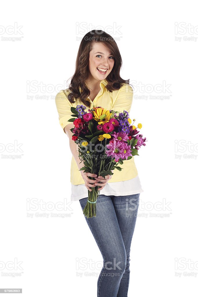 Teenager with a bouquet of flowers royalty-free stock photo