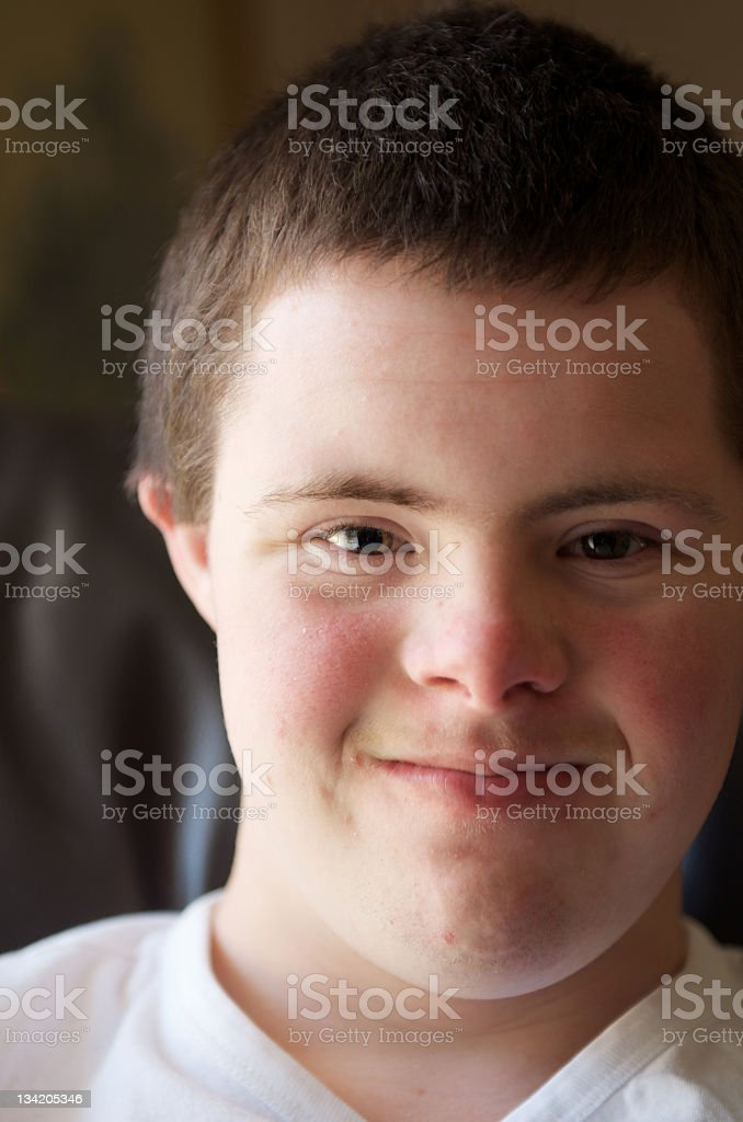 Teenager with a disability looking at camera stock photo