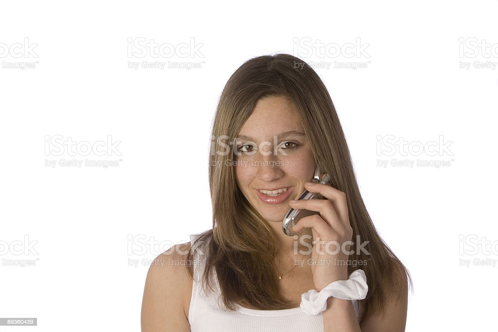 Teenager with cellphone to ear royalty free stockfoto