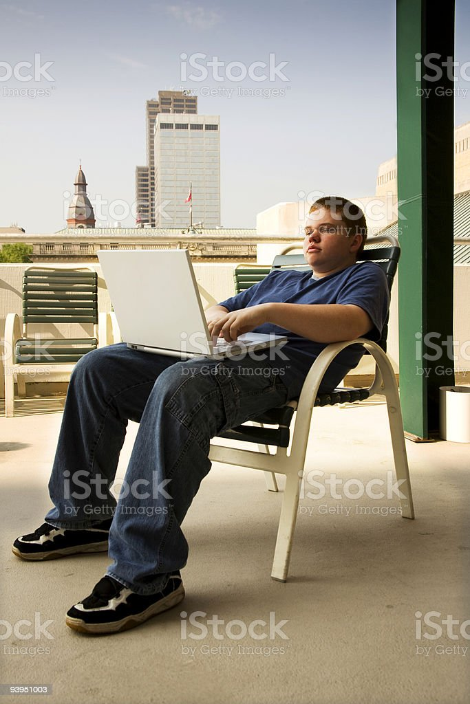 Teenager with computer royalty-free stock photo