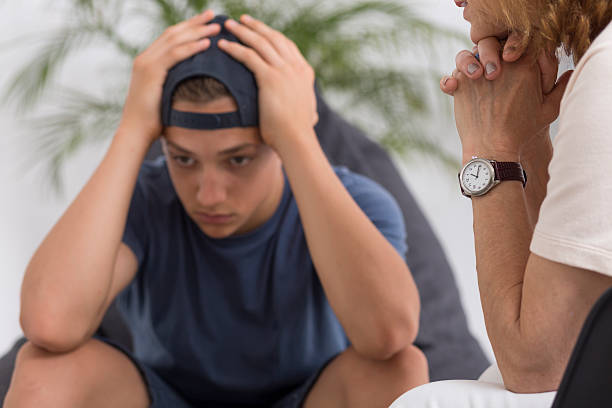 teenager with depression at psychologist - teen counseling stock photos and pictures