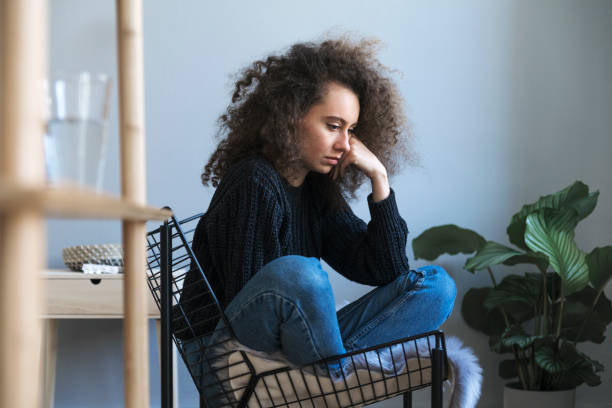 Teenager with depression sitting alone in room. Sadness, nostlagic, depression. Problems of young people. Teenager with depression. Sadness, nostlagic, depression. Problems of young people. drug rehab stock pictures, royalty-free photos & images