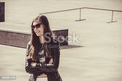 623358818 istock photo teenager with glasses in a leather jacket, darker girl 623361448