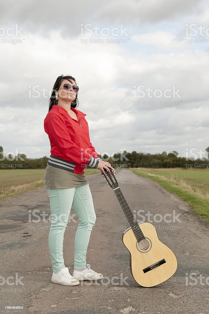 teenager with guitar royalty-free stock photo