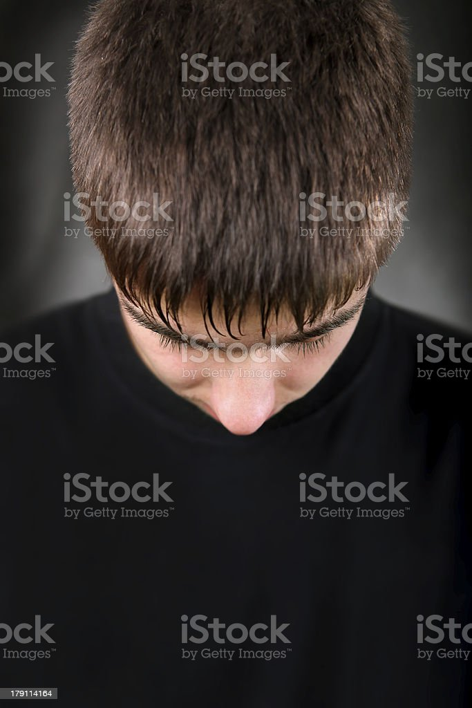 Teenager With Lowered Head stock photo