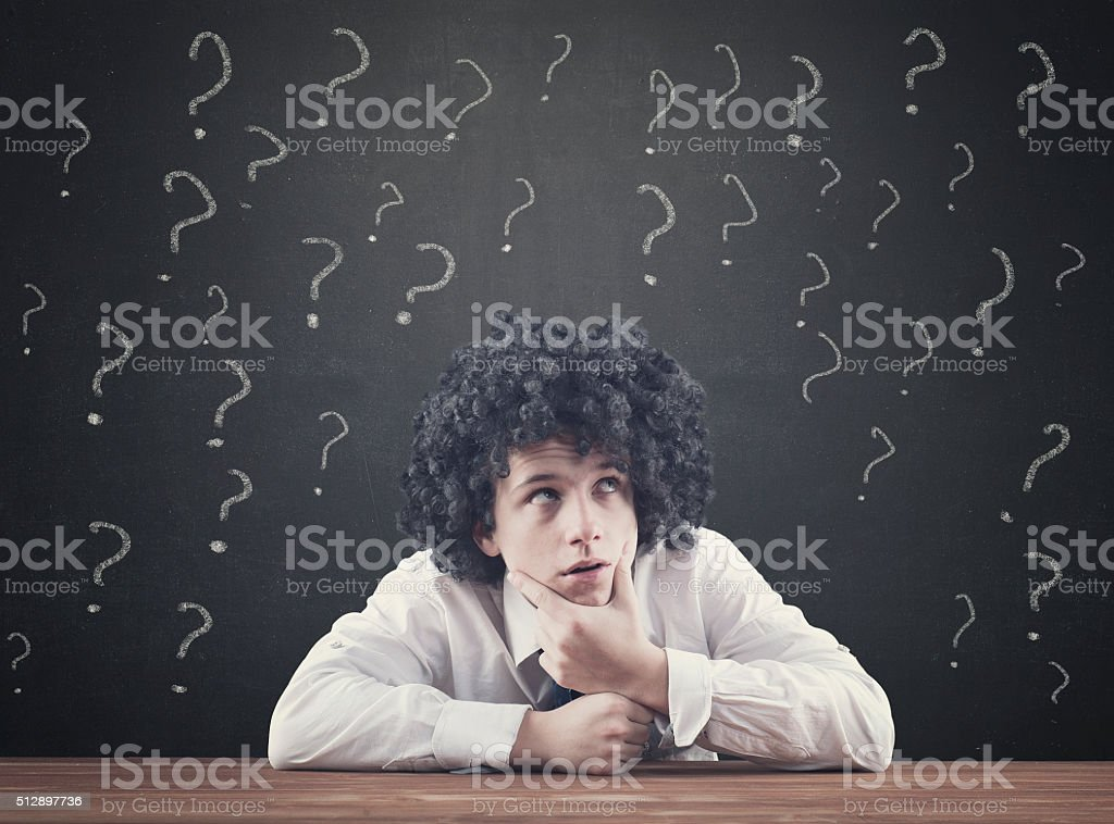 Teenager with many question mark stock photo