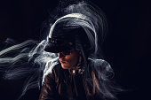 Teenager with motorcycle helmet light painting