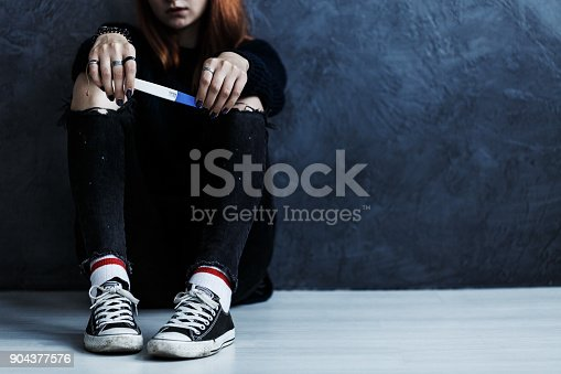 istock Teenager with pregnancy test 904377576