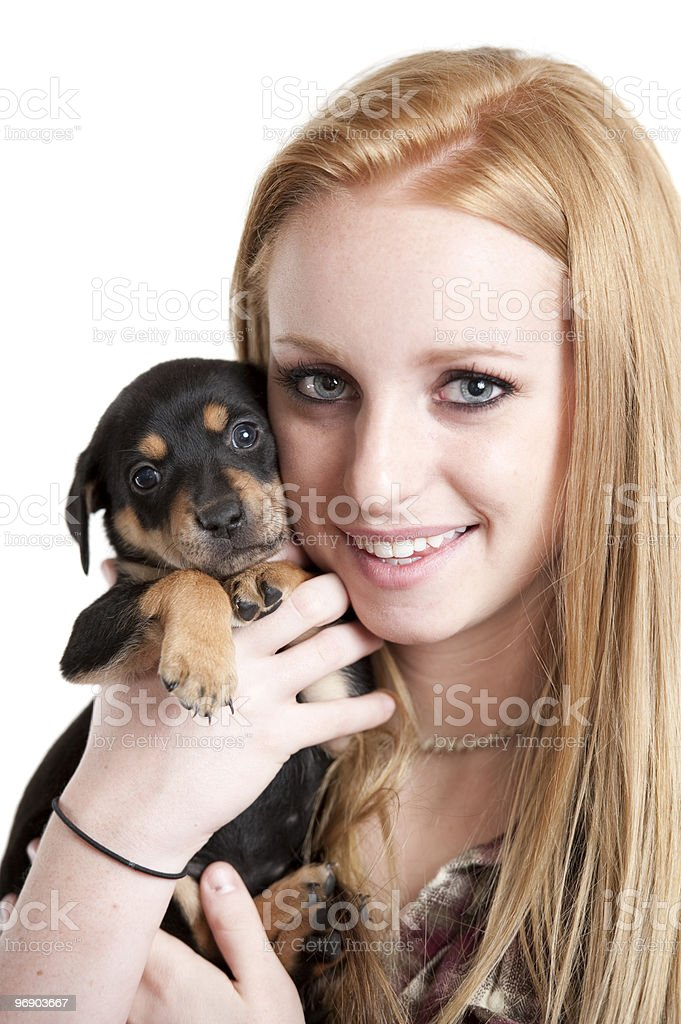 Teenager with puppy royalty-free stock photo