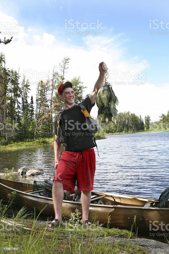 Teenager with Stringer of Huge Crappies stock photo