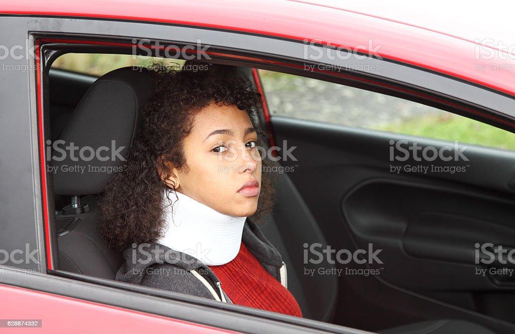 teenager with whiplash injury and neck brace stock photo