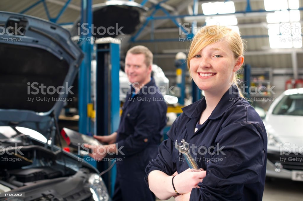 teenager working at the garage royalty-free stock photo