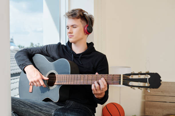 Teenager working on new song stock photo