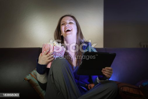 istock Teenager Youth Watching Movie and Streaming Video with Tablet Computer 183868063