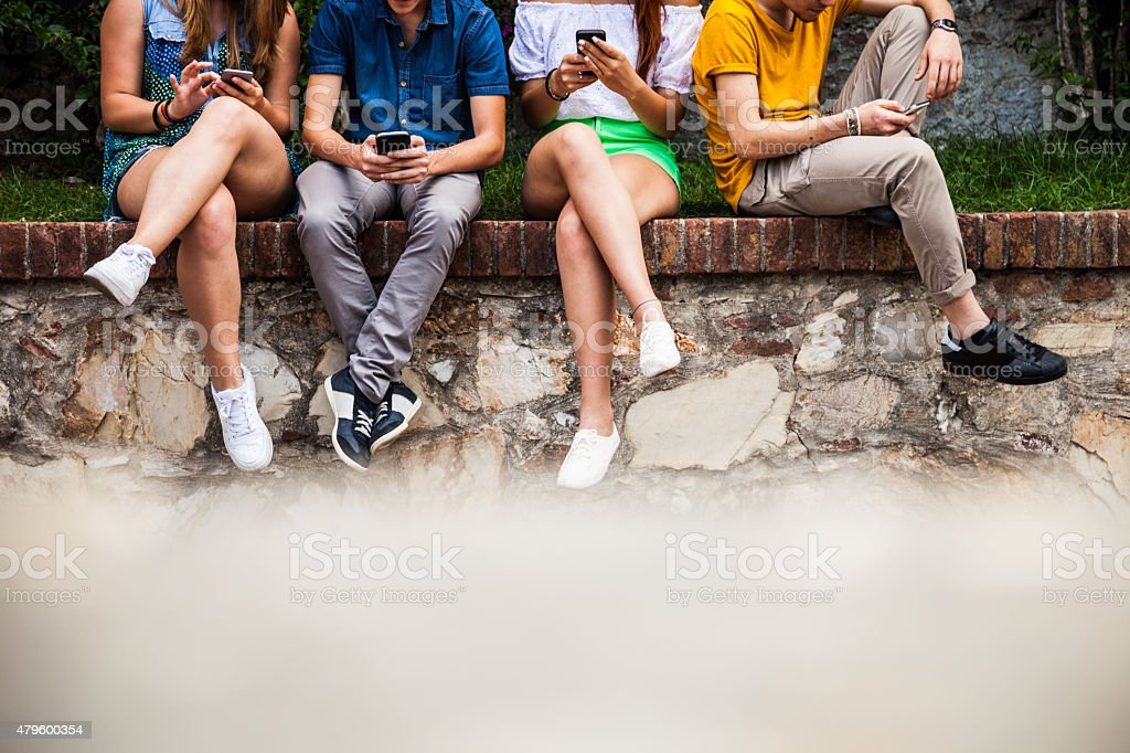 Teenagers addiction to smart phones and social media stock photo
