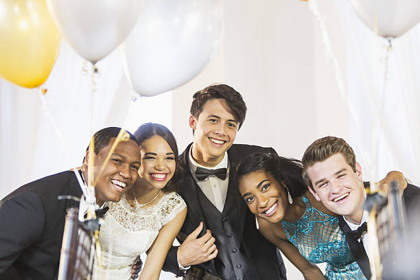 teenagers and young adults having fun at party - prom stock photos and pictures