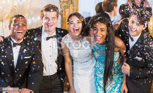 istock Teenagers and young adults in formalwear at party 637385112