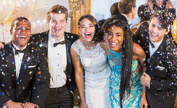teenagers and young adults in formalwear at party - soirées habillées photos et images de collection