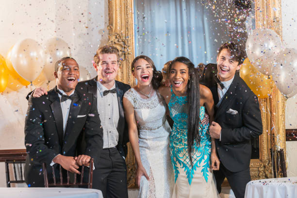 teenagers and young adults in formalwear at party - prom stock photos and pictures