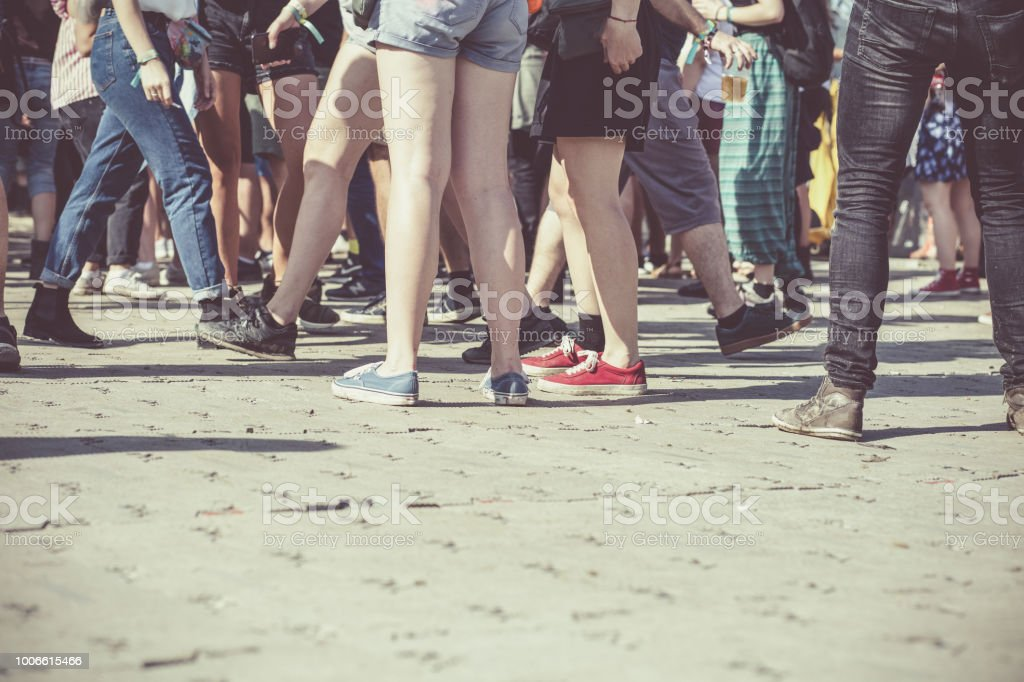 Teenagers at summer festival feet background stock photo