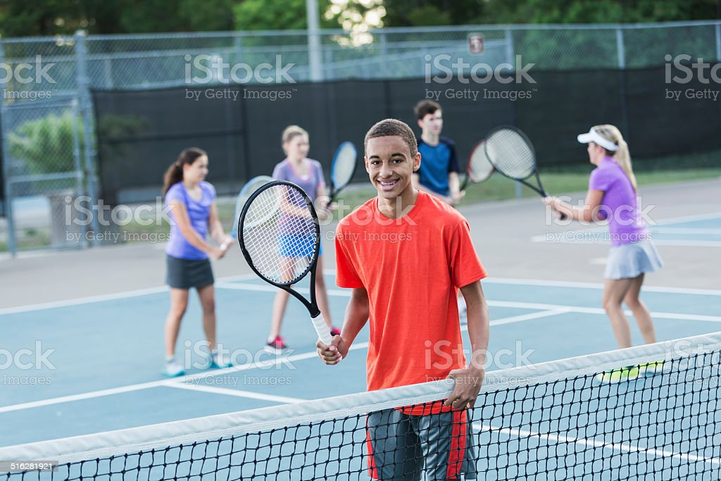 Teenagers at tennis clinic stock photo