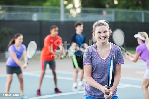istock Teenagers at tennis clinic 518656993
