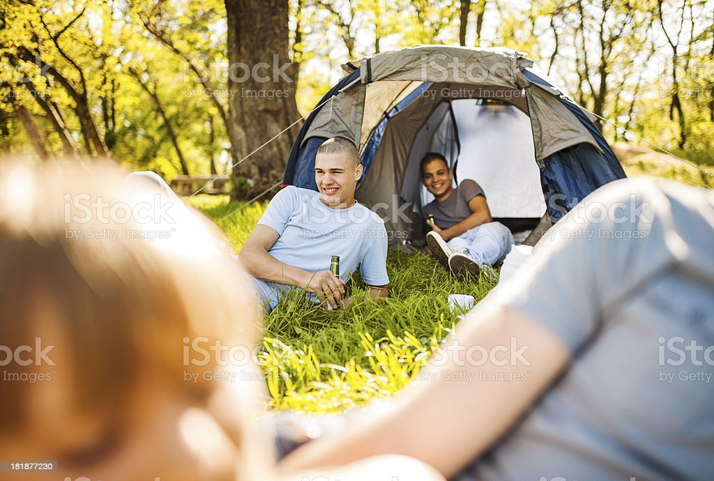 Teenagers camping. royalty-free stock photo