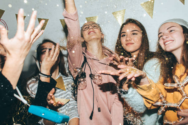 Teenagers celebrating New Year's Eve stock photo
