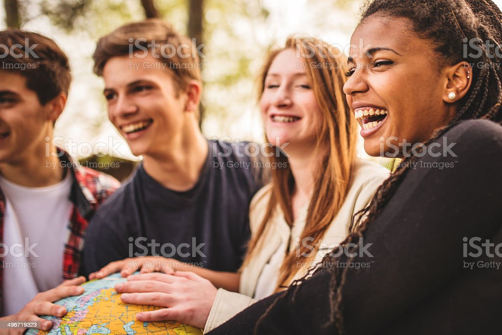 teenagers college student smiling with globe royalty-free stock photo