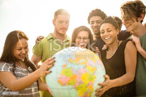 istock teenagers college student smiling with globe 503756842