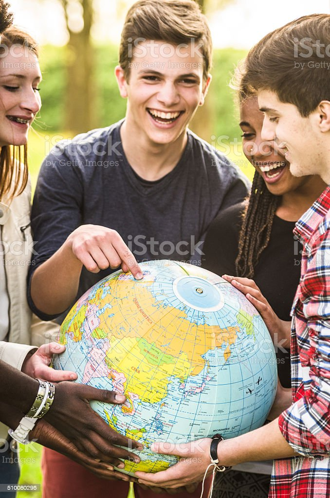 teenagers college student smiling with globe stock photo