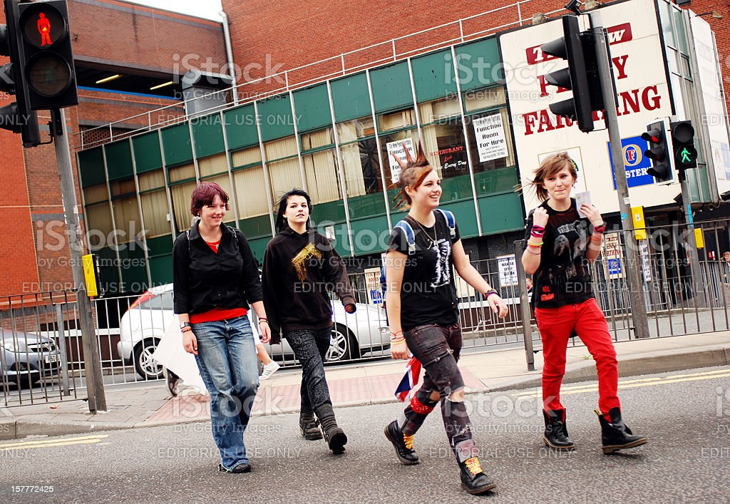 Teenagers crossing the road in Liverpool city centre stock photo