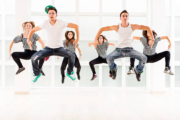 teenagers dancing modern dances. - dance group stock photos and pictures