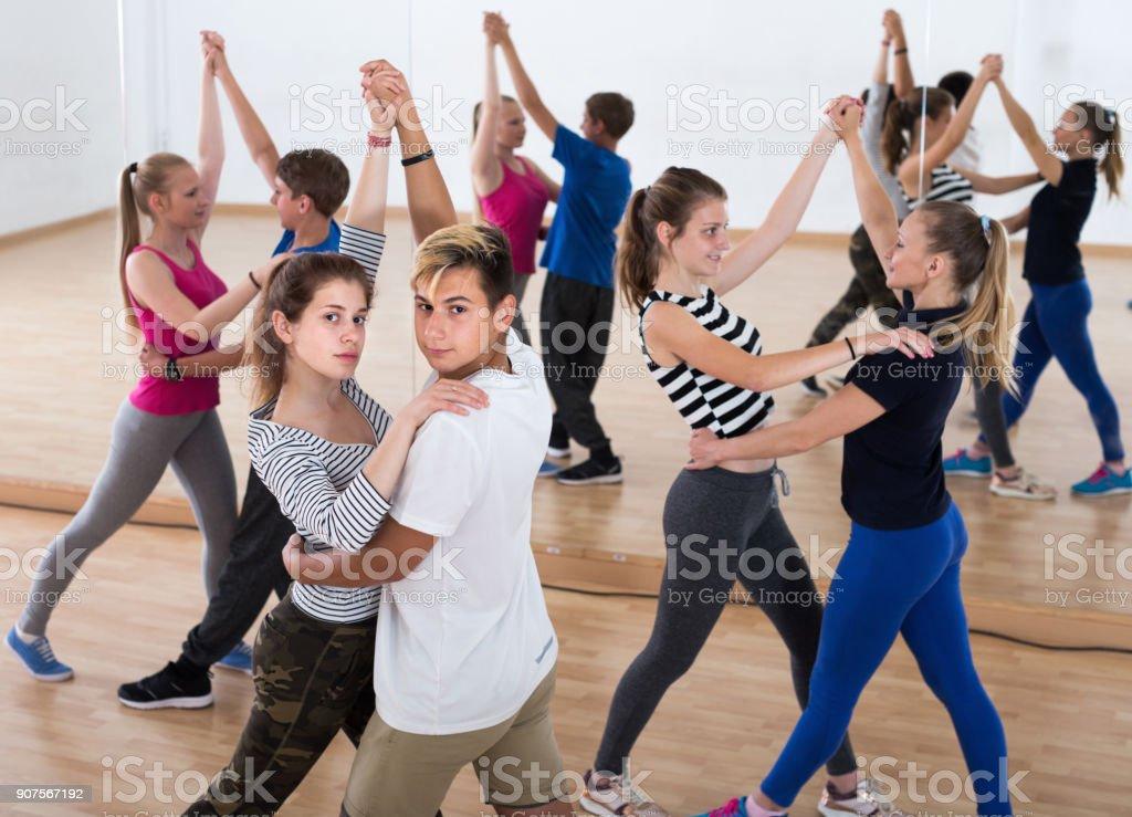 Teenagers dancing of partner dance in studio stock photo