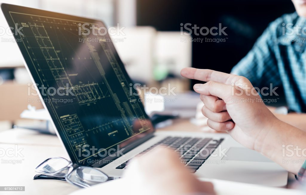Teenagers develop programming with blueprint code in laptop monitor. royalty-free stock photo