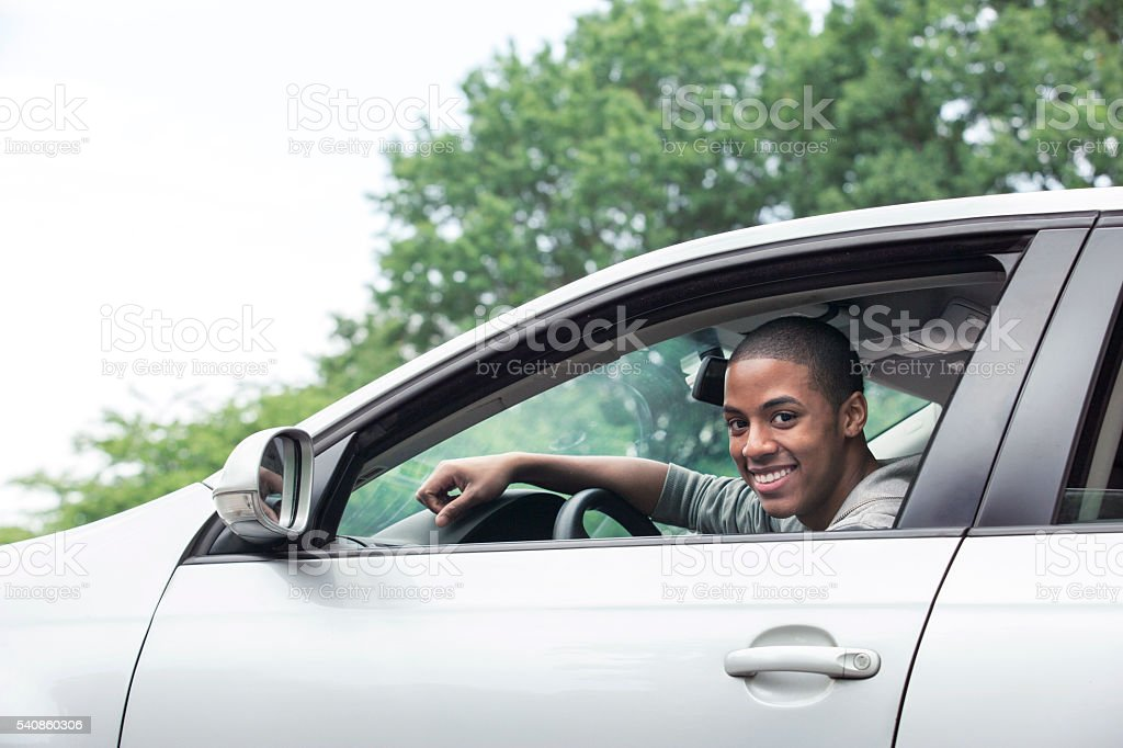 Teenagers driving car stock photo