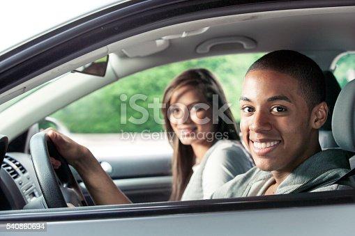 607592606 istock photo Teenagers driving car 540860694